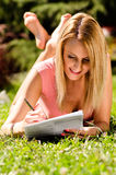 Pretty young woman reading documents Stock Photos