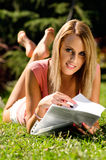 Pretty young woman reading documents Royalty Free Stock Images