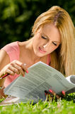 Pretty young woman reading documents Stock Photo