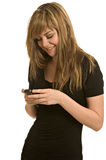 Pretty young woman reading text message royalty free stock photo