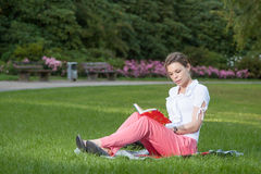 Pretty young woman reads a book Royalty Free Stock Images