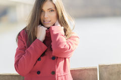 Pretty young woman in red coat Royalty Free Stock Image