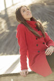 Pretty young woman in red coat Royalty Free Stock Photography