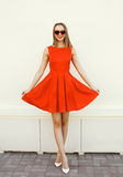Pretty young woman in the red dress and heart sunglasses Stock Photos