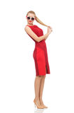 Pretty young woman in red dress isolated on white Stock Images