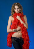Pretty Young Woman With Red Feather Boa Stock Photo
