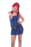Pretty young woman with red hair pointing Royalty Free Stock Images