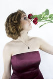 Pretty young woman with red roses Royalty Free Stock Images