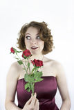 Pretty young woman with red roses Royalty Free Stock Photo
