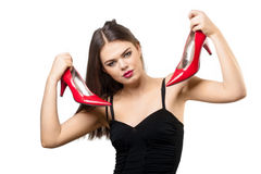 Pretty young woman with red shoes Royalty Free Stock Photo