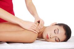 Pretty young woman relaxing being massaged Stock Image