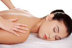Pretty young woman relaxing being massaged Royalty Free Stock Photo