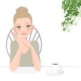 Pretty young woman relaxing with coffee Royalty Free Stock Photo
