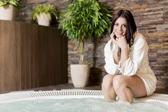 Young woman relaxing in the hot tub Royalty Free Stock Images