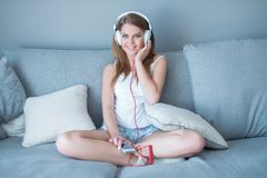 Pretty young woman relaxing listening to music Royalty Free Stock Image
