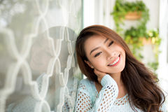 Pretty young woman relaxing in the morning. Pretty young woman relaxing in the morning Stock Photography