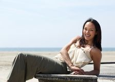 Pretty young woman relaxing outdoors Royalty Free Stock Photos