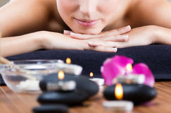 Pretty young woman relaxing at spa Royalty Free Stock Image