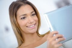 Pretty young woman relaxing with tablet computer Stock Photo
