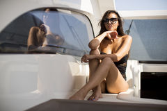 Pretty young woman relaxing on the yacht Royalty Free Stock Photo