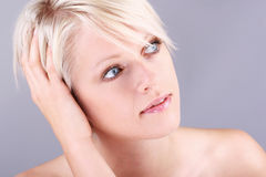 Pretty young woman reminiscing Royalty Free Stock Images