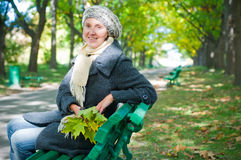 Pretty young woman resting on a bench Royalty Free Stock Image