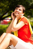Pretty young woman resting in the park Royalty Free Stock Images