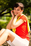 Pretty young woman resting in the park Stock Photography