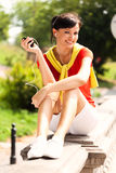 Pretty young woman resting in the park Royalty Free Stock Image