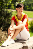 Pretty young woman resting in the park Stock Photo