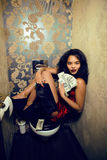 Pretty young woman in restroom with money Royalty Free Stock Image