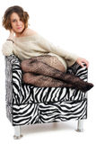 Pretty young woman on retro chair Royalty Free Stock Photography