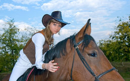 Pretty young woman riding  horse. Stock Photos