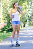 Pretty young woman on roller skates Royalty Free Stock Images