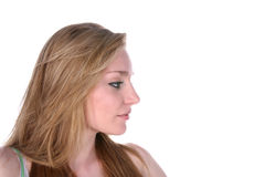 Pretty young woman's profile over white Royalty Free Stock Photo