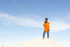 Pretty young woman on sand dune at storm Royalty Free Stock Images