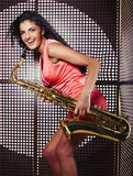 Pretty young woman with saxophone Stock Image