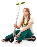 Pretty young woman with scooter Royalty Free Stock Photography