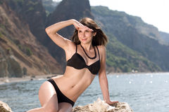 Pretty young woman at the sea Royalty Free Stock Images