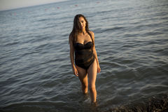 Pretty young woman in the sea royalty free stock photos
