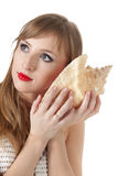Pretty young woman and seashell Royalty Free Stock Photo
