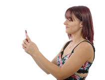 Pretty young woman sending a text message Royalty Free Stock Photos
