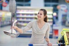 Pretty, young woman shopping Stock Photos