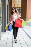 Pretty young woman in shopping Stock Photos