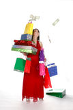 Pretty young woman shopping. Pretty young woman with shopping bags, boxes, and dropped money Royalty Free Stock Image