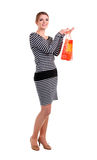 Pretty young woman with shopping bag over white Royalty Free Stock Photos