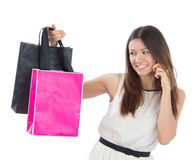 Pretty young woman with shopping bags buying presents Stock Photos