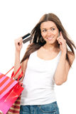 Pretty young woman shopping bags talking by phone Stock Photo