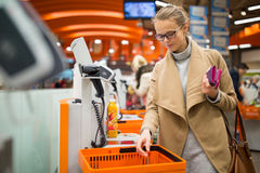 Free Pretty, Young Woman Shopping For Some Fruit And Smoothie Stock Photos - 85904903