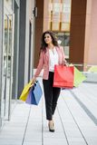 Pretty young woman in shopping Stock Photography
